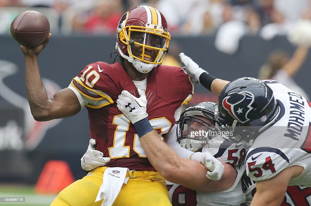 Washington Redskins quarterback <a gi-track='captionPersonalityLinkClicked' href=/galleries/search?phrase=Robert+Griffin&family=editorial&specificpeople=2495030 ng-click='$event.stopPropagation()'>Robert Griffin</a> III #10 is sacked by Houston Texans linebacker Brooks Reed #58 and linebacker Mike Mohamed #54 in the second quarter on September 7, 2014 at NRG Stadium in Houston, Texas.