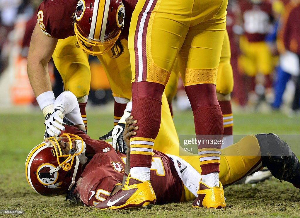 Washington Redskins quarterback Robert Griffin III (10) lies on the field after injuring his leg while trying to recover a fumble in the fourth quarter against the Seattle Seahawks in an NFC wild-card playoff game at FedEx Field in Landover, Maryland, Sunday, January 6, 2013. The Seahawks defeated the Redskins, 24-14.