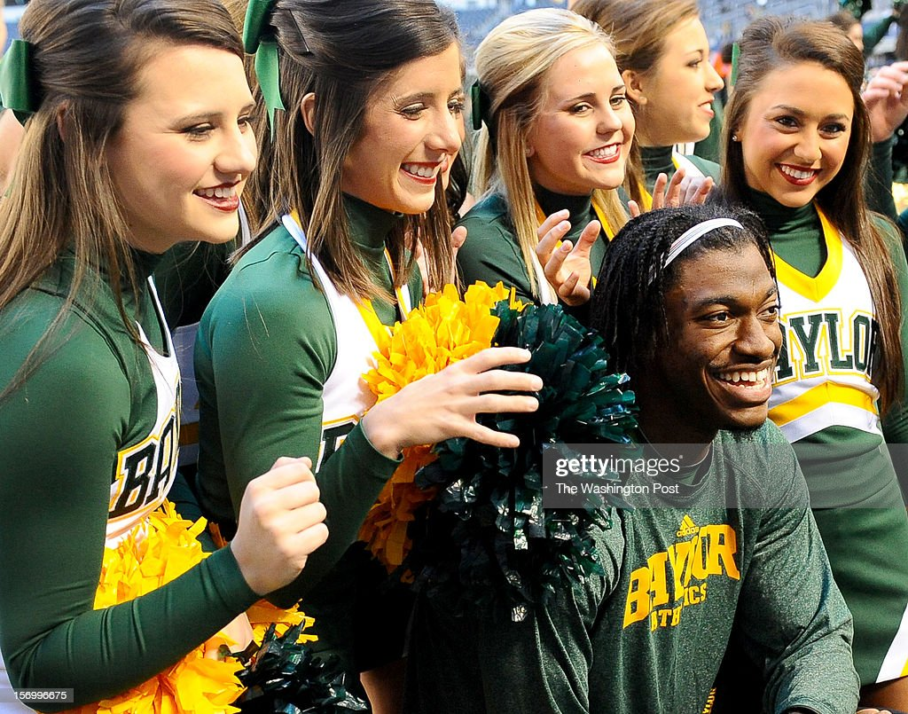 Washington Redskins quarterback Robert Griffin III (10) poses with the Baylor cheerleaders prior to the Baylor game against Texas Tech at Cowboys stadium on November. 24, 2012 in Arlington, TX