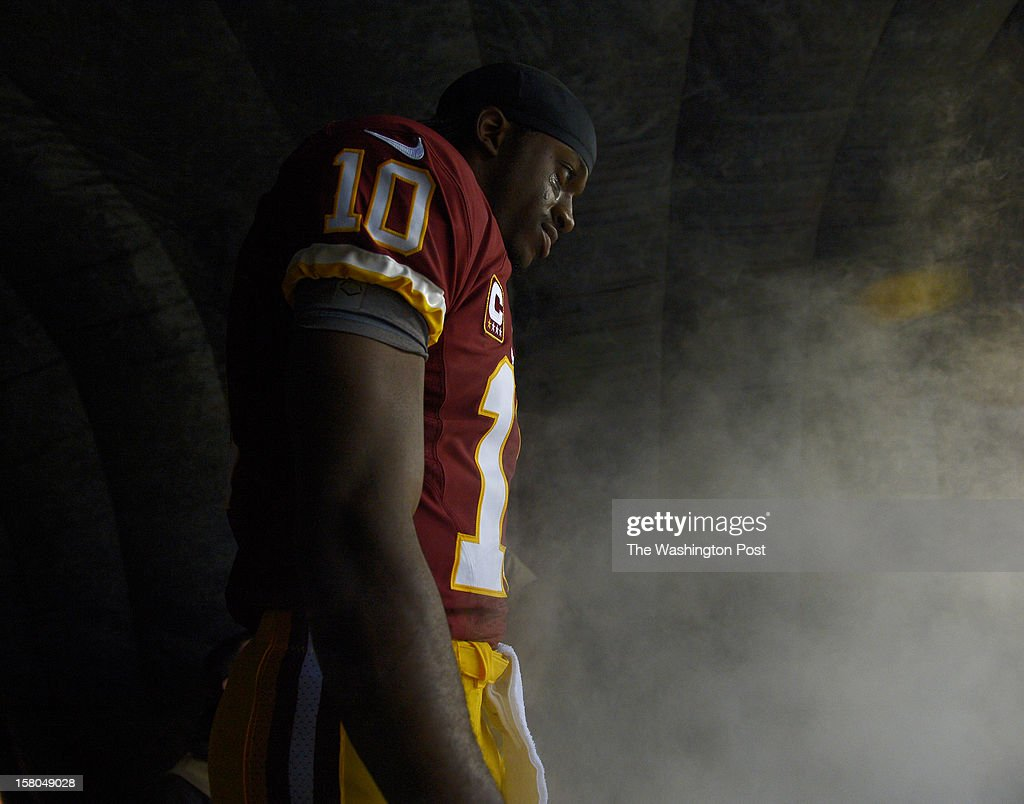 Washington Redskins quarterback Robert Griffin III (10) prepares to step on the field before a game between the Baltimore Ravens and Washington Redskins at FedEx Field on December 9, 2012 in Landover, Md.