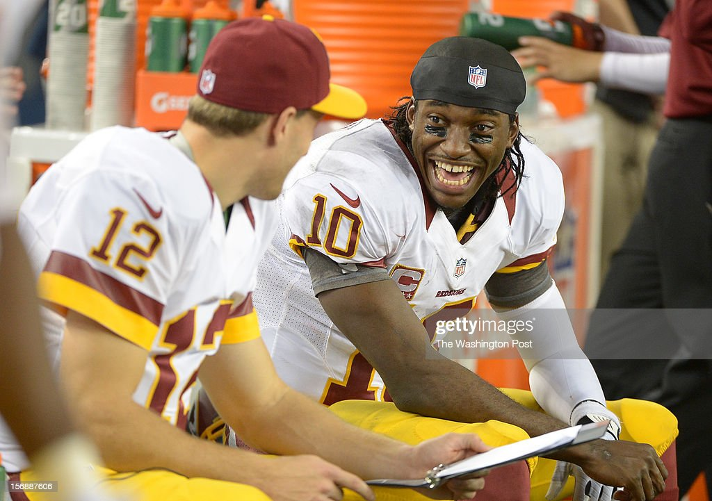Washington Redskins quarterback Robert Griffin III (10) shares a laugh with quarterback Kirk Cousins (12) during 4th quarter action against the Dallas Cowboys on November. 22, 2012 in Arlington, TX