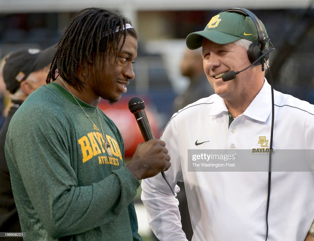 Washington Redskins quarterback Robert Griffin III (10) talks with Baylor radio sideline reporter and former Washington Redskins Ricky Thompson during the Baylor game against Texas Tech at Cowboys stadium on November. 24, 2012 in Arlington, TX
