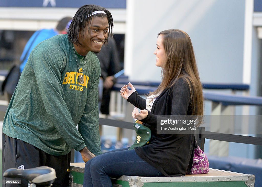 Washington Redskins quarterback Robert Griffin III (10) talks with his fiance Rebecca Liddicoat prior to the Baylor game against Texas Tech at Cowboys stadium on November. 24, 2012 in Arlington, TX