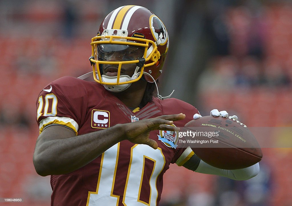 Washington Redskins quarterback Robert Griffin III (10) warms up before a game between the Baltimore Ravens and Washington Redskins at FedEx Field on December 9, 2012 in Landover, Md.
