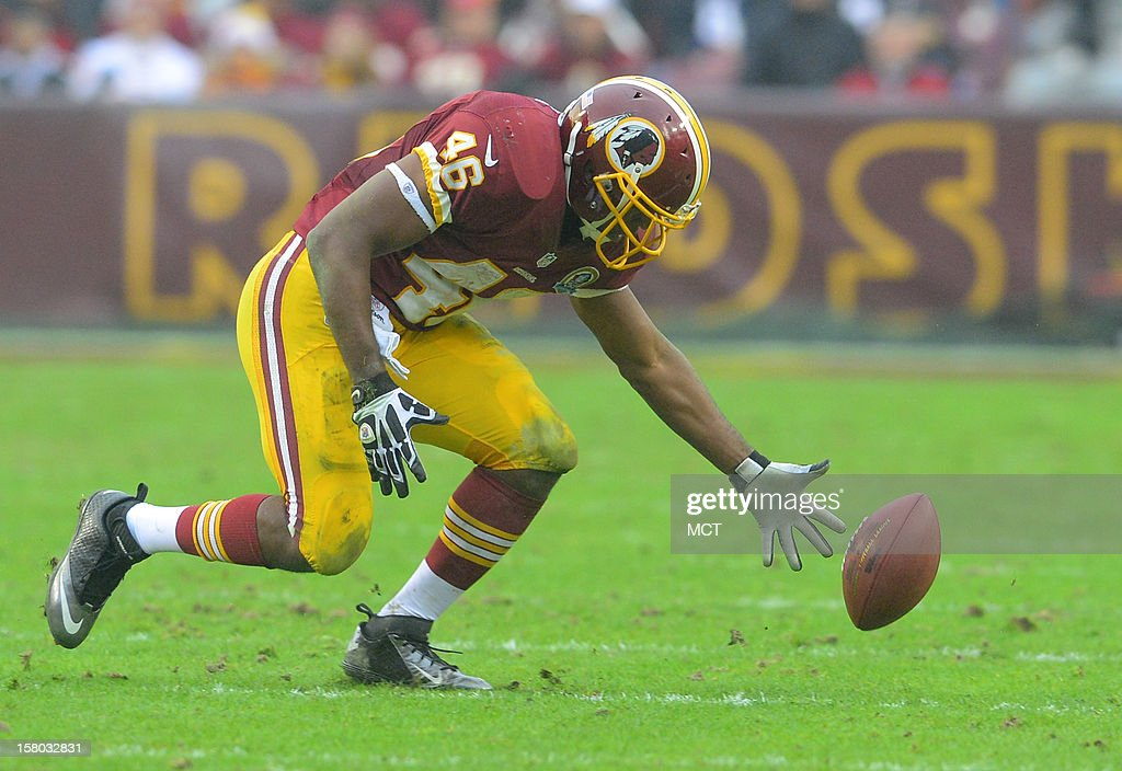 Washington Redskins running back Alfred Morris can't corral a pitch from teammate Robert Griffin III during the first half of their game with Baltimore in Landover, Maryland, on Sunday, December 9, 2012. Washington takes a 31-28 win over Baltimore in overtime.