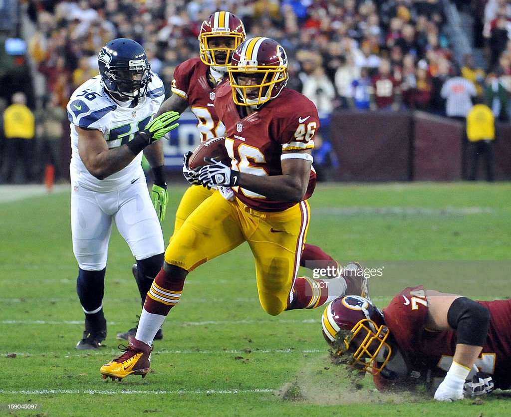 Washington Redskins running back Alfred Morris (46) carries against the Seattle Seahawks in the first quarter of an NFC wild-card playoff game at FedEx Field in Landover, Maryland, Sunday, January 6, 2012.