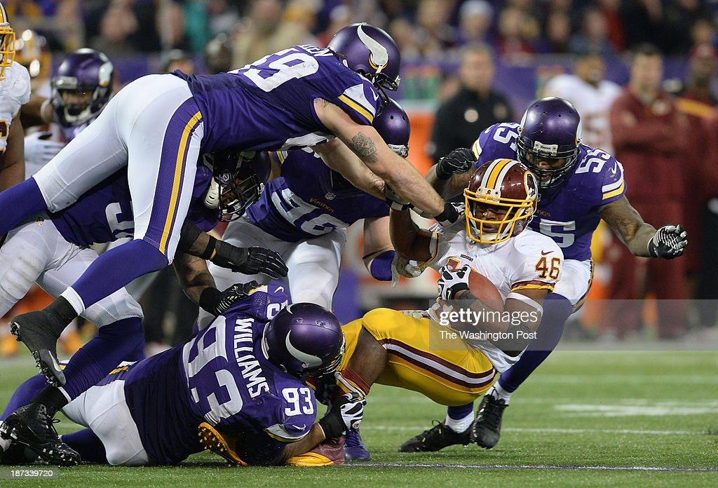 Washington Redskins running back Alfred Morris (46) is brought down by Minnesota Vikings defensive tackle Kevin Williams (93) during the fourth quarter of the game between the Washington Redskins and the Minnesota Vikings at the Hubert H. Humphrey Metrodome in Minneapolis, Mn., on Thursday, November 7, 2013.