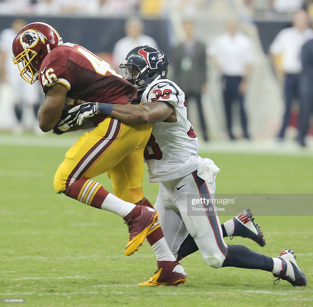 Washington Redskins running back <a gi-track='captionPersonalityLinkClicked' href=/galleries/search?phrase=Alfred+Morris&family=editorial&specificpeople=6350964 ng-click='$event.stopPropagation()'>Alfred Morris</a> #46 is tackled by Houston Texans defensive back <a gi-track='captionPersonalityLinkClicked' href=/galleries/search?phrase=Danieal+Manning+-+American+Football+Player&family=editorial&specificpeople=589817 ng-click='$event.stopPropagation()'>Danieal Manning</a> #38 in the third quarter on September 7, 2014 at NRG Stadium in Houston, Texas.