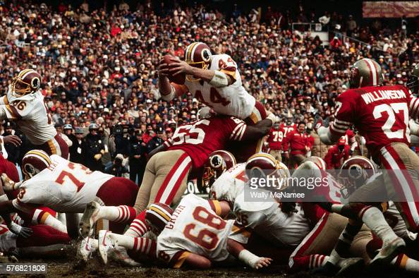 Washington Redskins running back John Riggins leaps over the defense to score a touchdown during the NFC Championship game against the San Francisco...