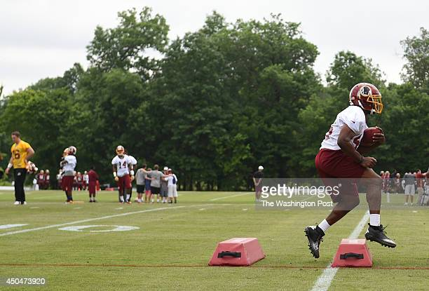 Washington Redskins running back Roy Helu works on his agility during their final round of organized team activities on June 11 2014 in Ashburn VA