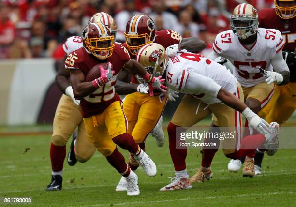 Washington Redskins runningback Chris Thompson attempts to elude a host of San Francisco 49ers defensive players while rushing upfield during a...