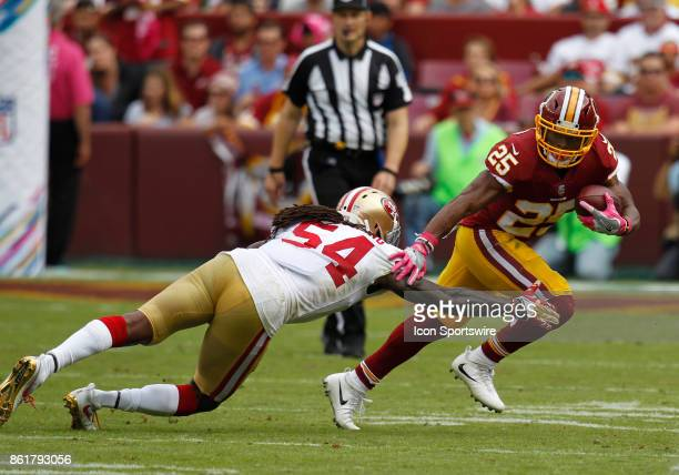 Washington Redskins runningback Chris Thompson attempts to elude San Francisco 49ers linebacker RayRay Armstrong while rushing upfield during a...