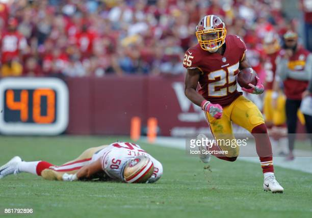 Washington Redskins runningback Chris Thompson disgards and eludes San Francisco 49ers linebacker Brock Coyle while rushing upfield during a football...