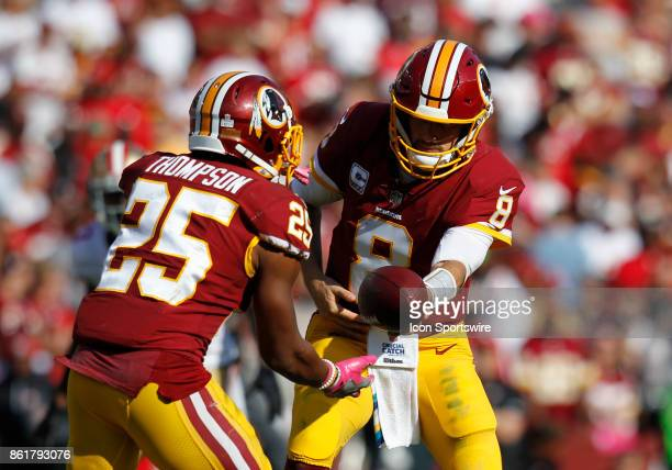 Washington Redskins runningback Chris Thompson prepares to receive the ball from quarterback Kirk Cousins in the backfield during a football game...
