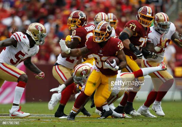 Washington Redskins runningback Samaje Perine attempts to elude San Francisco 49ers linebacker RayRay Armstrong while rushing upfield during a...
