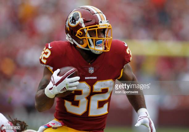 Washington Redskins runningback Samaje Perine takes the handoff and rushes upfield during a football game between the San Francisco 49ers and...