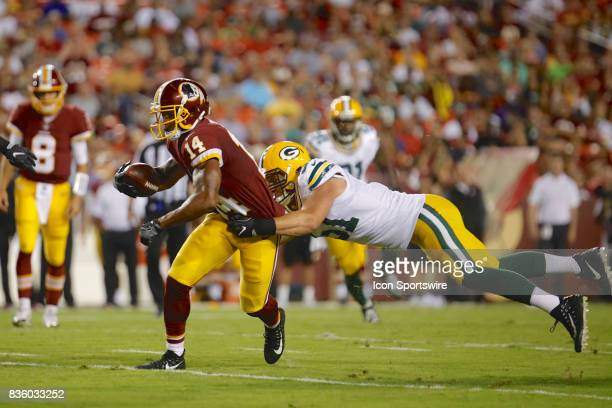 Washington Redskins Ryan Grant breaks a tackle during the NFL preseason game between the Green Bay Packers and the Washington Redskins at FedEx Field...