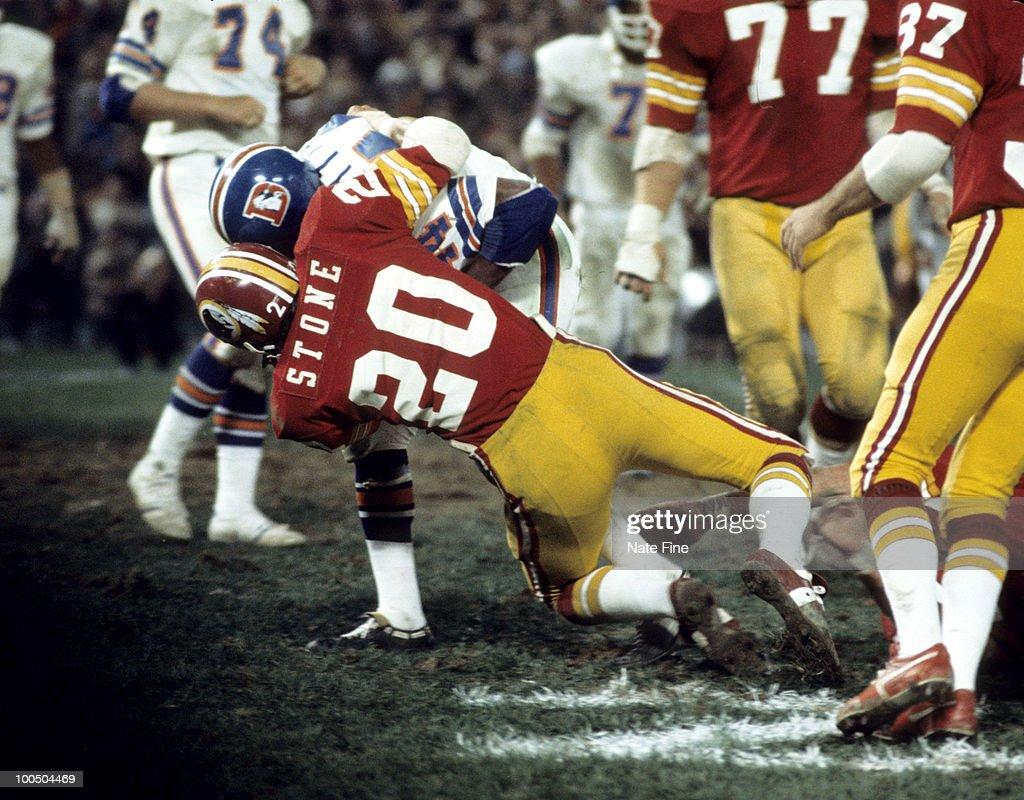 Washington Redskins safety Ken Stone (20) stops Broncos running back Floyd Little (44) during the Redskins 30-3 victory over the Denver Broncos on September 30, 1974 at RFK Stadium in Washington, D.C.