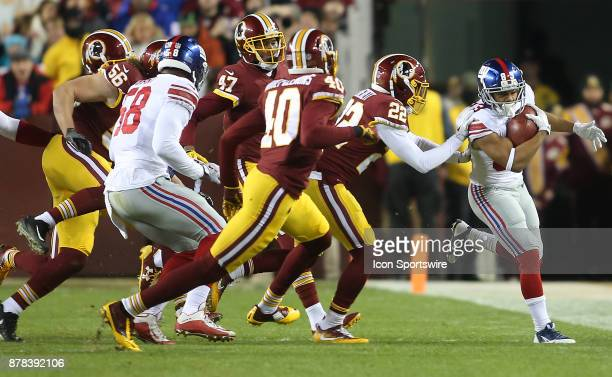 Washington Redskins strong safety Deshazor Everett pushes New York Giants wide receiver Kalif Raymond out of bounds in the first quarter during a NFL...
