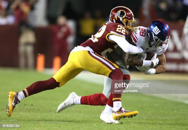 Washington Redskins strong safety Deshazor Everett tackles New York Giants tight end Evan Engram during a NFL game between the Washington Redskins...