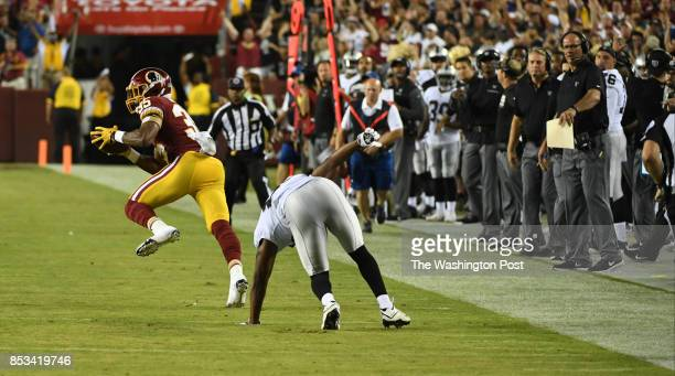 Washington Redskins strong safety Montae Nicholson takes off after intercepting a pass against the Oakland Raiders early in the first quarter at...