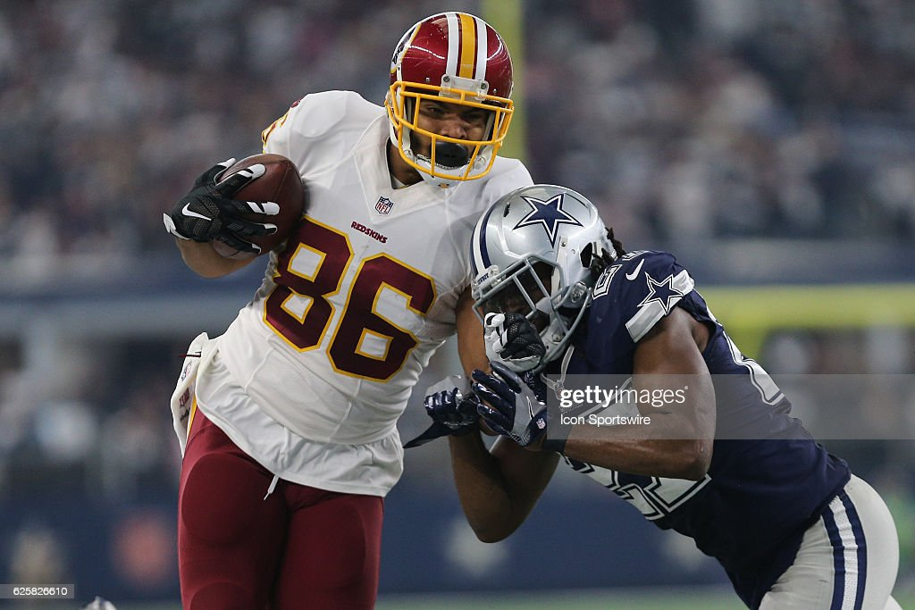 Washington Redskins tight end Jordan Reed (86) gets tackled by Dallas Cowboys strong safety J.J. Wilcox (27) during the NFL game between the Dallas Cowboys and the Washington Redskins on November 24, 2016 at AT&T Stadium in Arlington, TX. Dallas beats Washington 31-26.