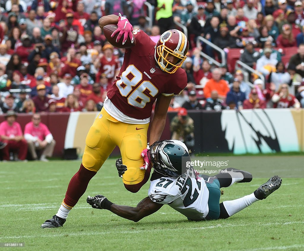 Washington Redskins tight end Jordan Reed is brought down by Philadelphia Eagles free safety Malcolm Jenkins after Reed completed a pass for a first...