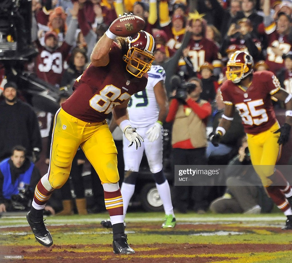 Washington Redskins tight end Logan Paulsen (82) celebrates after scoring on a touchdown pass against the Seattle Seahawks in the first quarter of an NFC wild-card playoff game at FedEx Field in Landover, Maryland, Sunday, January 6, 2012.