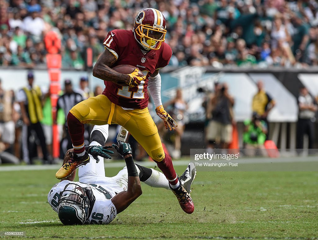 Washington Redskins wide receiver DeSean Jackson (11) hauls in an 81- yard touchdown pass as Philadelphia Eagles cornerback <a gi-track='captionPersonalityLinkClicked' href=/galleries/search?phrase=Cary+Williams+-+American+Football+Player&family=editorial&specificpeople=10178470 ng-click='$event.stopPropagation()'>Cary Williams</a> (26) fails to stop him in the third quarter during the game between the Washington Redskins and the Philadelphia Eagles at Lincoln Financial Field on Sunday, September 21, 2014. The Philadelphia Eagles defeated the Washington Redskins 37-34. Photo by Toni L. Sandys/The Washington Post via Getty Images)