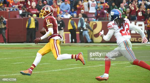 Washington Redskins wide receiver DeSean Jackson heads for the end zone and a touchdown after completing a pass ahead of New York Giants strong...
