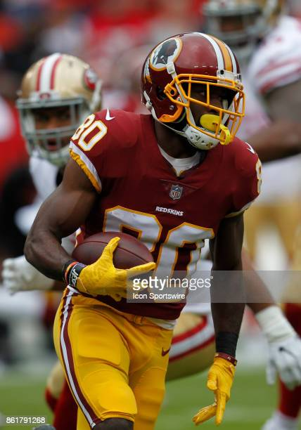 Washington Redskins wide receiver Jamison Crowder attempts to elude a host of San Francisco 49ers defensive players while rushing upfield during a...