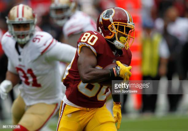 Washington Redskins wide receiver Jamison Crowder attempts to elude San Francisco 49ers defensive end Arik Armstead while rushing upfield during a...