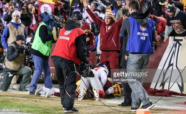 Washington Redskins wide receiver Josh Doctson and New York Giants cornerback Janoris Jenkins end up in a corner of Fedex Field after Doctson had...
