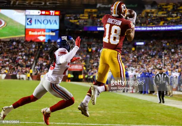 Washington Redskins wide receiver Josh Doctson leaps over New York Giants cornerback Janoris Jenkins for the Redskins go ahead touchdown in the...