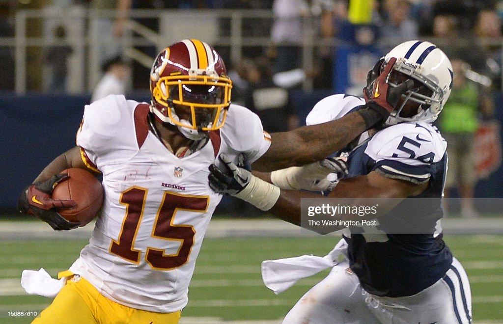 Washington Redskins wide receiver Josh Morgan (15) stiff arms Dallas Cowboys inside linebacker Bruce Carter (54) on a 4th quarter run on November. 22, 2012 in Arlington, TX