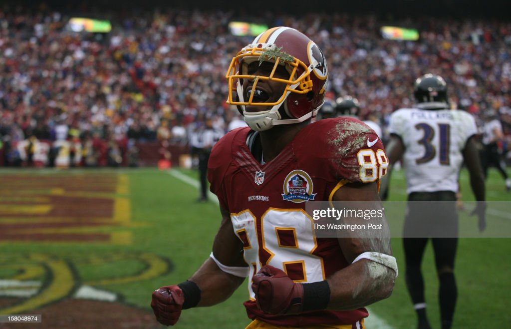 Washington Redskins wide receiver Pierre celebrates a pass completion that helped set up Washington's first touchdown early in the first quarter as the Washington Redskins play the Baltimore Ravens at FedEx Field in Landover, Md, on December 9, 2012.