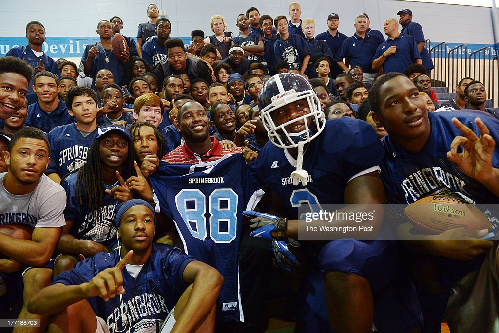 Washington Redskins wide receiver Pierre Garcon (88) is surrounded by players from the Springbrook High School football team after donating new uniforms to the team at the school on Tuesday, August 20, 2013. Garcon is providing new football jerseys to three area schools: Thomas Jefferson (Va.), Theodore Roosevelt (DC) and Springbrook (Md.).