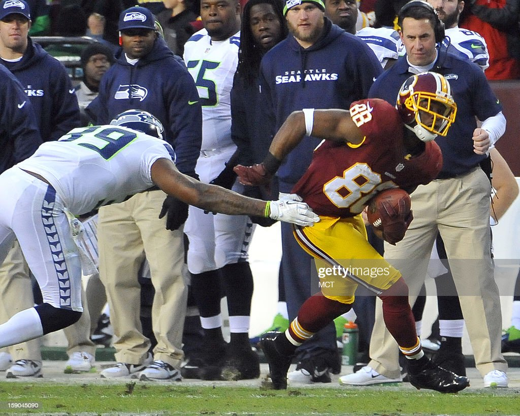 Washington Redskins wide receiver Pierre Garcon (88) slips a tackle by Seattle Seahawks cornerback Brandon Browner (39) after a catch in the first quarter of an NFC wild-card playoff game at FedEx Field in Landover, Maryland, Sunday, January 6, 2012.