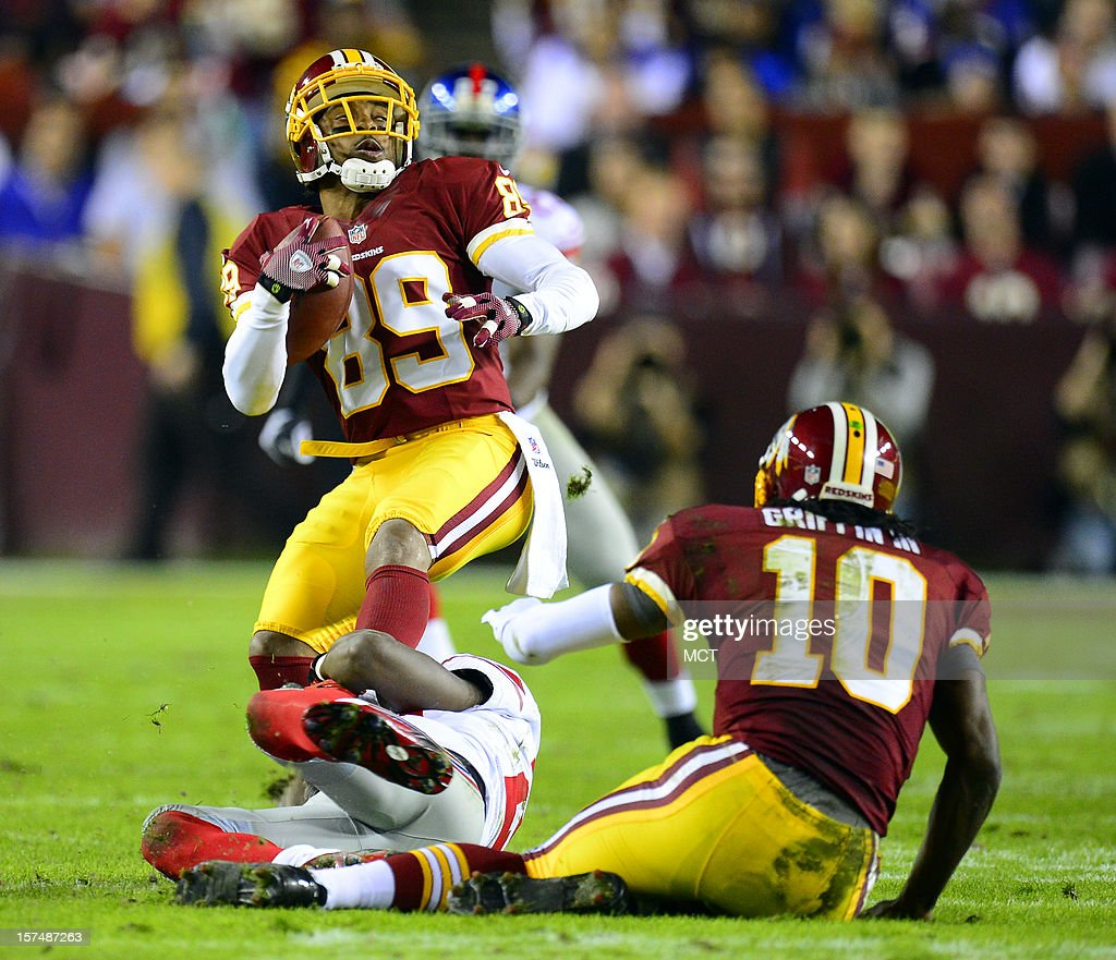 Washington Redskins wide receiver Santana Moss (89) is tackled by New York Giants cornerback Prince Amukamara (20), on ground, in the second quarter at FedEx Field in Landover, Maryland, Monday, December 3, 2012/.