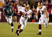 Washington Redskins wide receiver Santana Moss races to the endzone after making the winning touchdown catch in overtime action October 1 2006 at...