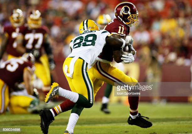 Washington Redskins wide receiver Terrelle Pryor runs past Green Bay Packers cornerback Josh Hawkins during a match between the Washington Redskins...