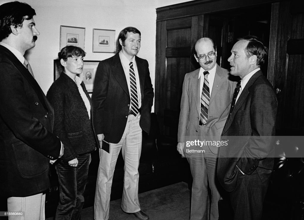 Rep Bill Archer RTexas talks with the three Romanian gymnastics trainers April 8th who have defected to the United States Shown are Geza Pozsar Marta...