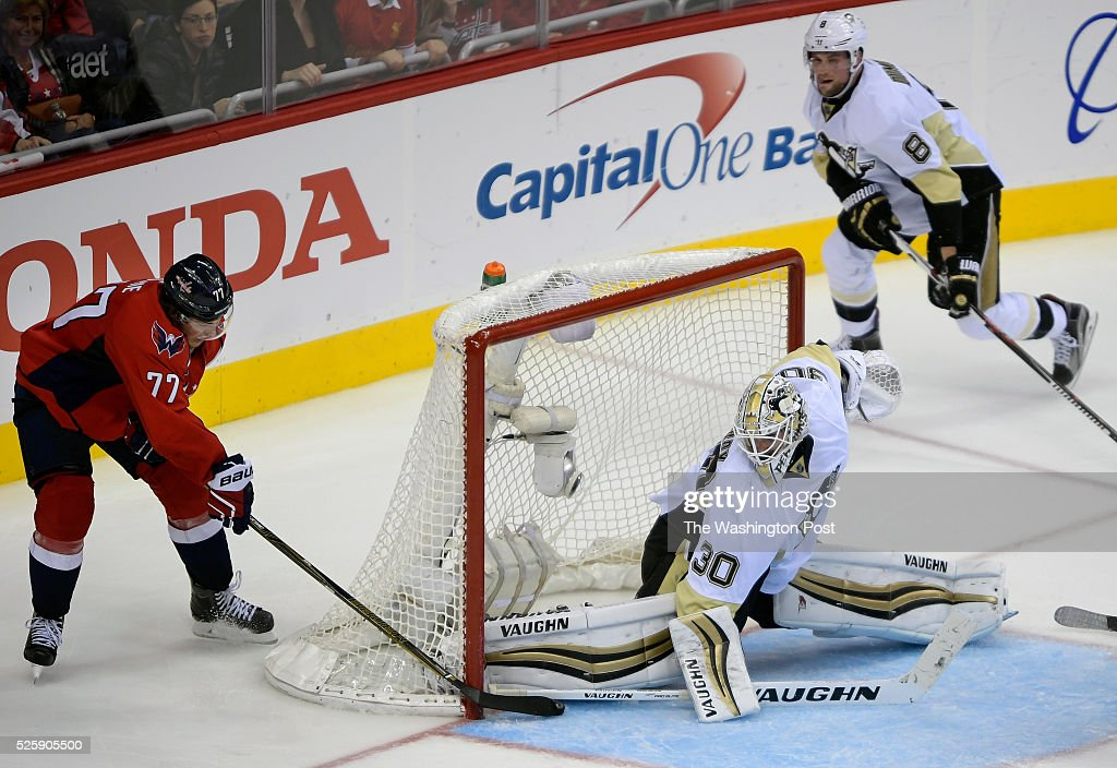 Washington right wing T.J. Oshie (77), left, score the game winning goal against Pittsburgh goalie Matt Murray (30) during the Washington Capitals defeat of the Pittsburgh Penguins 4 -3 in OT in Game one of the NHL Eastern Conference Second Round at the Verizon Center in Washington DC, April 28, 2016.