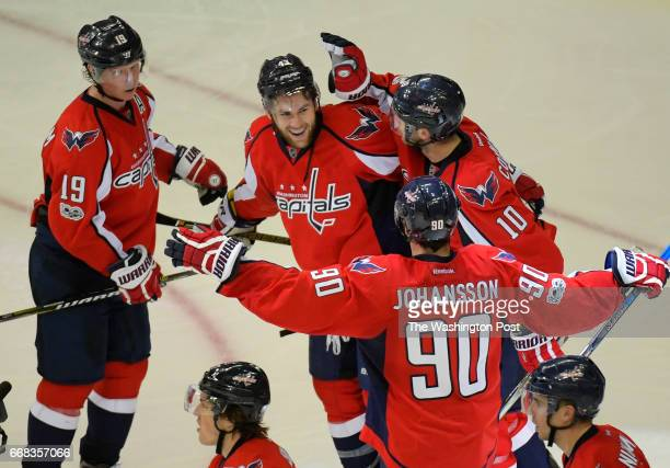 Washington right wing Tom Wilson center celebrates the game winning goal during the Washington Capitals defeat of the Toronto Maple Leafs 3 2 in...