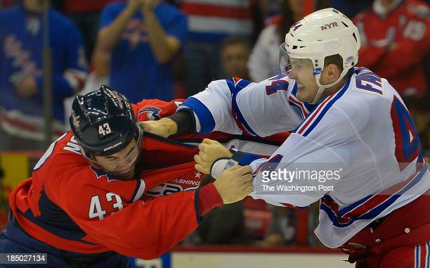 Washington right wing Tom Wilson l eft and New York defenseman Justin Falk fight it out just beforethe end ofthe 1st period as the Washington...