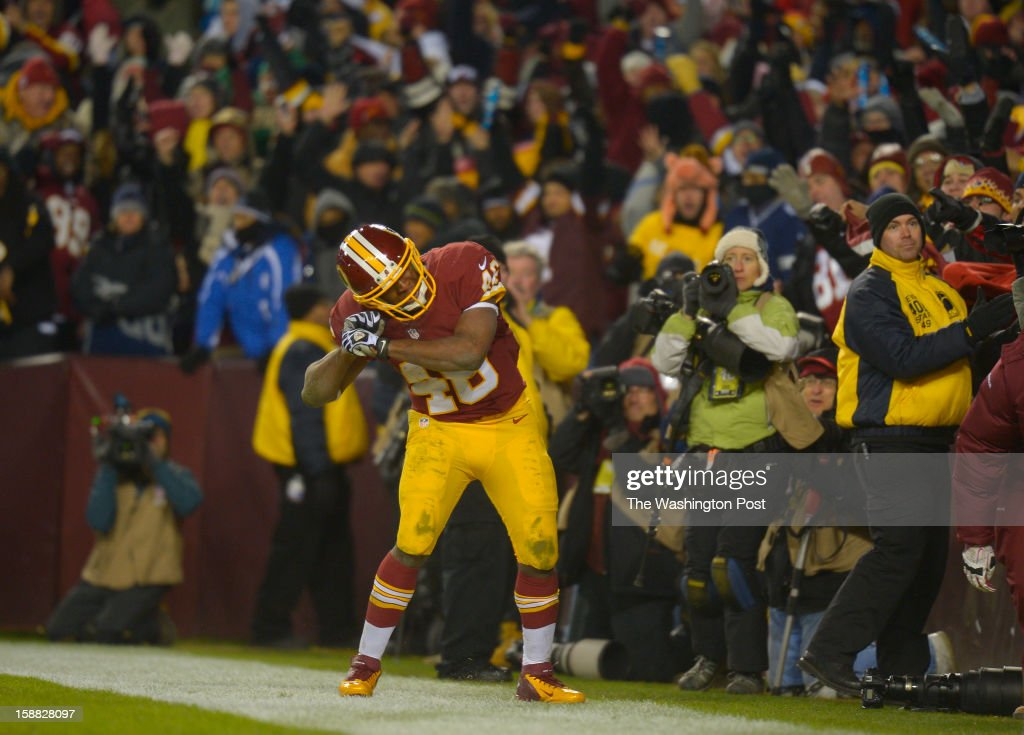 Washington running back Alfred Morris (46) does his signature homerun swing after scoring a third-quarter touchdown as the Washington Redskins play the Dallas Cowboys for first place of the NFC East division and a playoff spot at FedEx in Landover MD, December 30, 2012 .