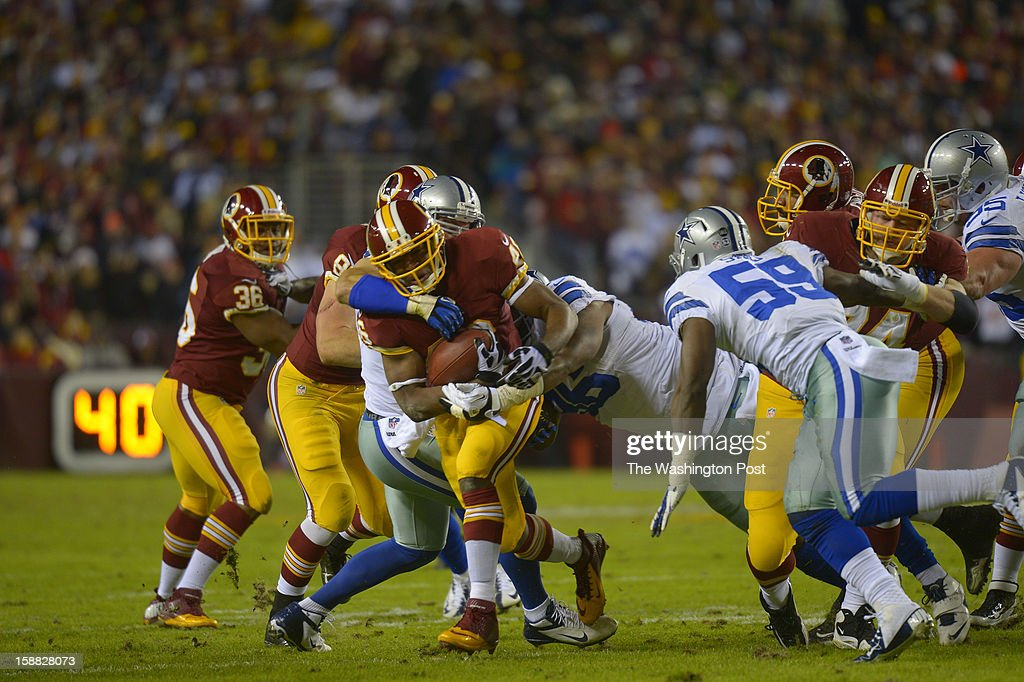Washington running back Alfred Morris (46) fights for yardage in the first quarter as the Washington Redskins play the Dallas Cowboys for first place of the NFC East division and a playoff spot at FedEx in Landover MD, December 30, 2012 .