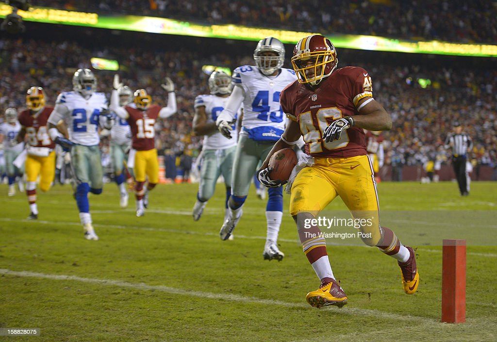 Washington running back Alfred Morris (46) steps into the endzone for a second-quarter touchdown to tie the score at 7 as the Washington Redskins play the Dallas Cowboys for first place of the NFC East division and a playoff spot at FedEx in Landover MD, December 30, 2012 .