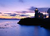 USA, Washington, San Juan Island, Lime Kiln Lighthouse, sunset