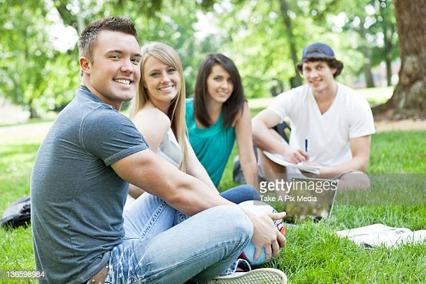 USA, Washington, Seattle, Portrait of college students relaxing on grass